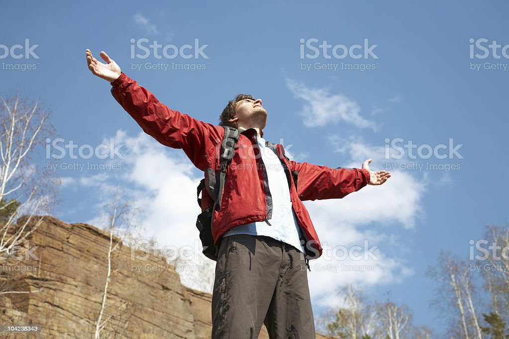 Happy man hiker holding his arms royalty-free stock photo