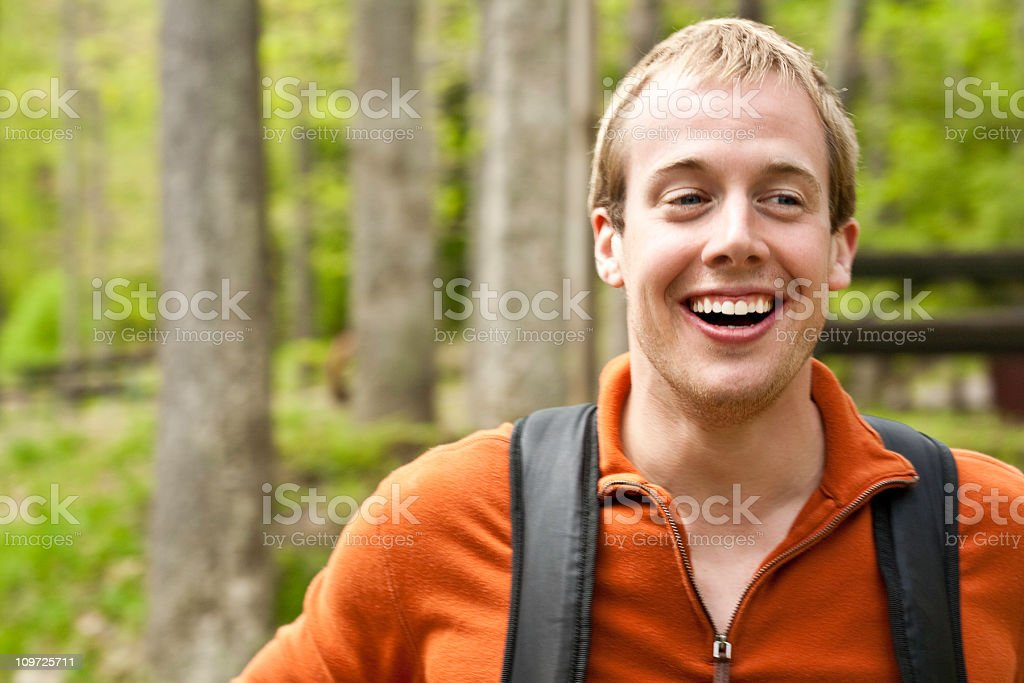 Happy Man Hiking Through the Forest royalty-free stock photo