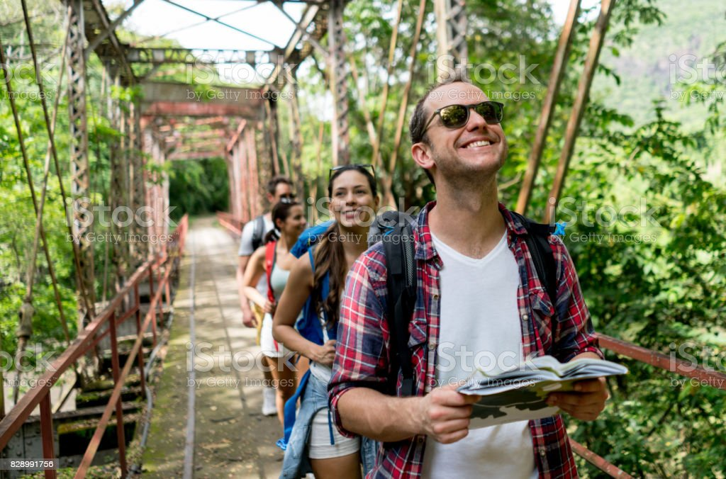 Happy man hiking with a group stock photo