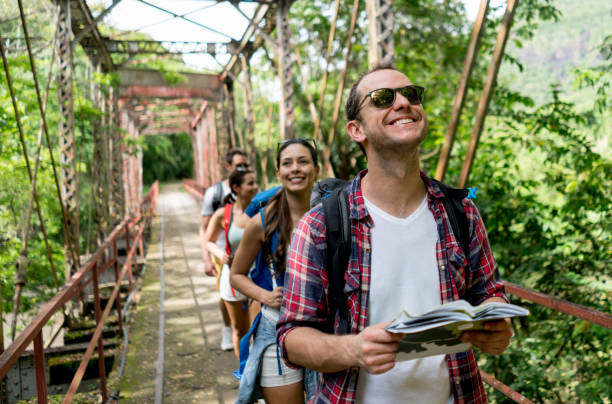 happy man hiking with a group - south america travel stock photos and pictures