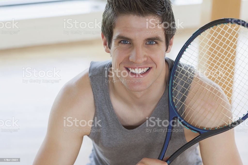 Happy man holding a tennis racket royalty-free stock photo