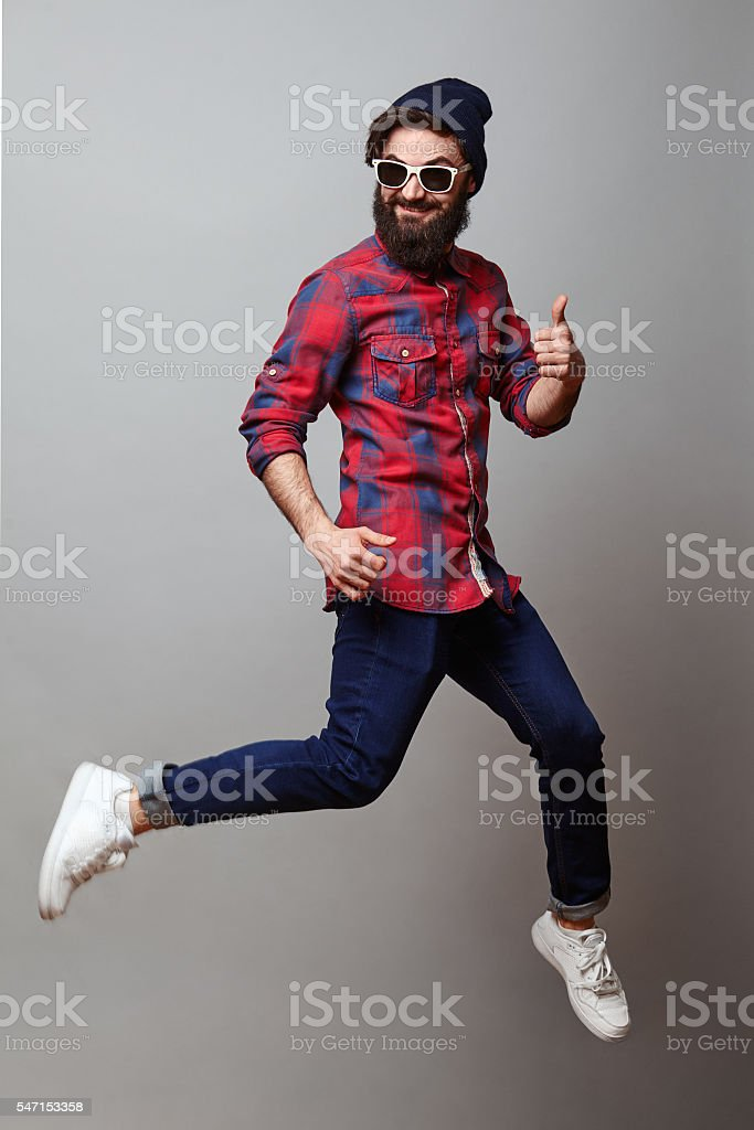 Happy man in air with thumbs up stock photo