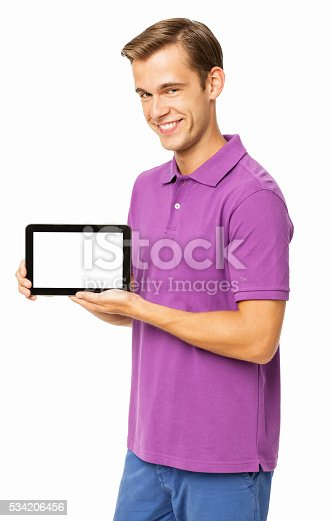 682621548istockphoto Happy Man In Casuals Holding Digital Tablet 534206456