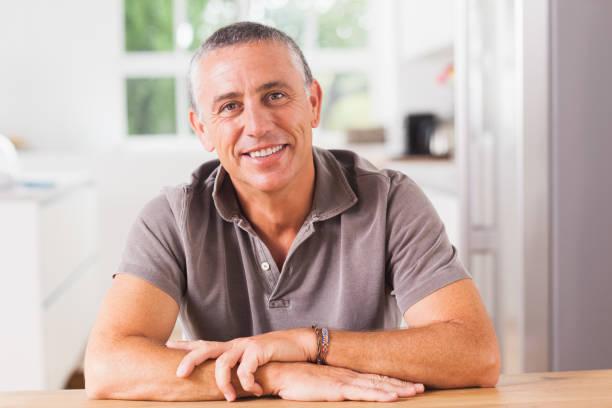 Happy man in kitchen stock photo