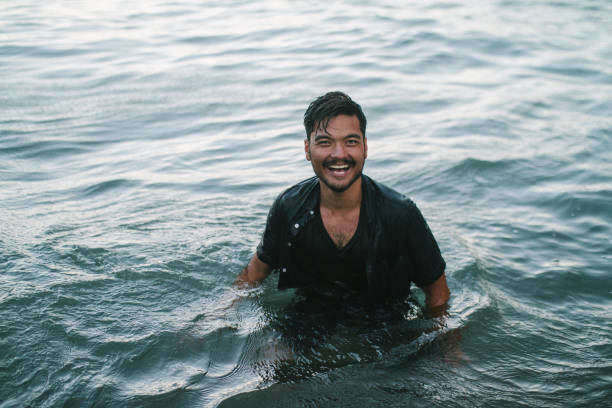 Happy Man in Ocean stock photo