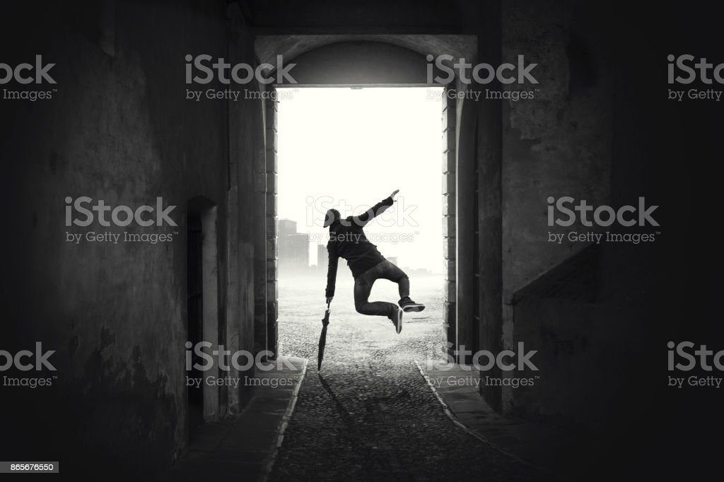 happy man jumping happy despite the bad weather stock photo