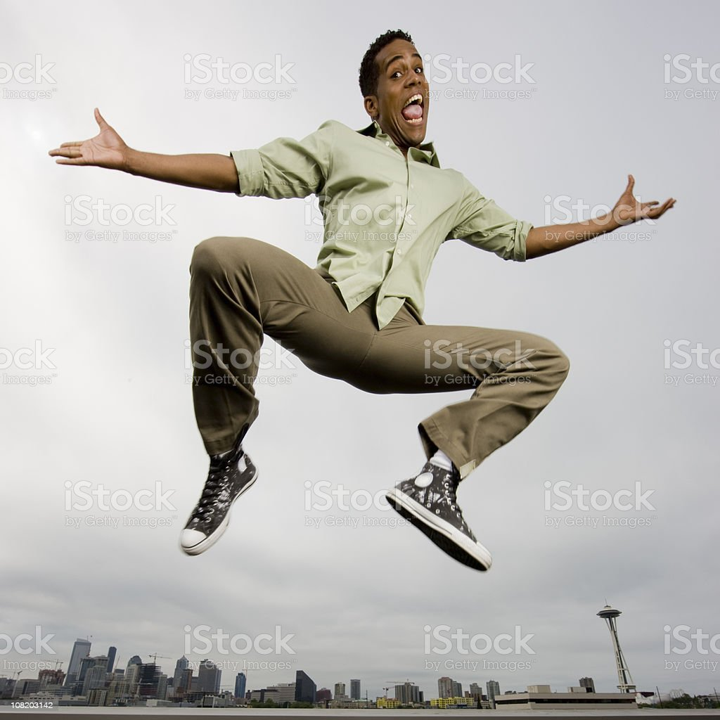 Happy Man Jumping in Air royalty-free stock photo