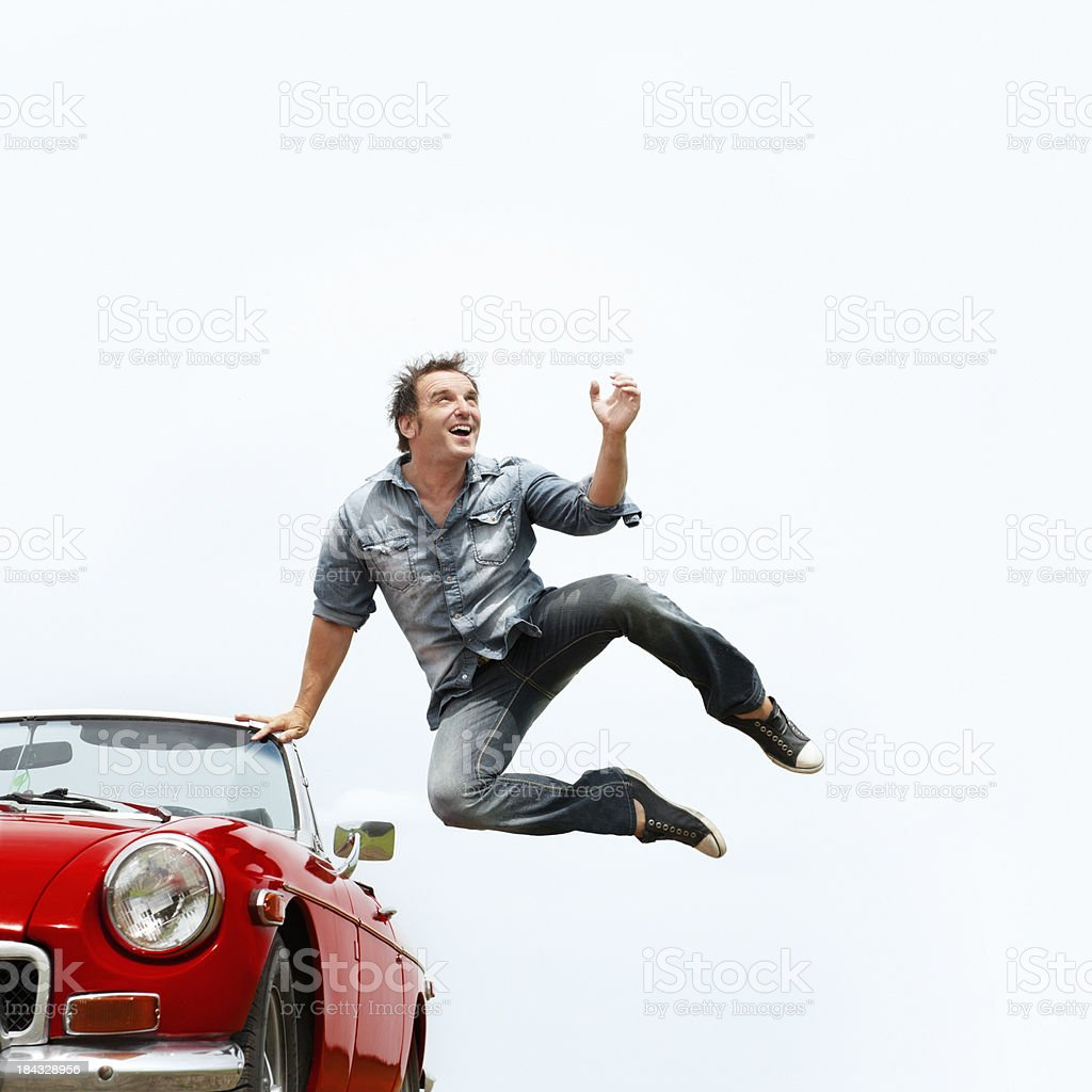 Happy man jumping stock photo