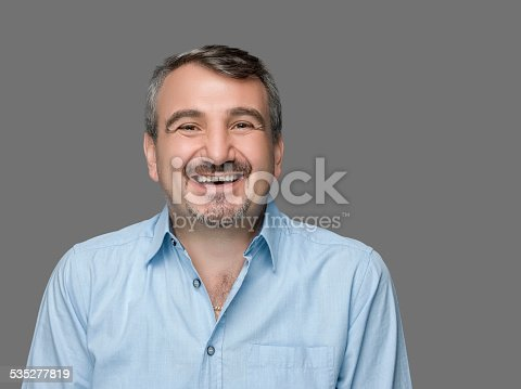 istock Happy man laughing 535277819