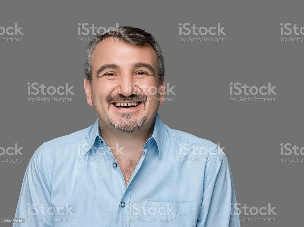 Happy man laughing stock photo