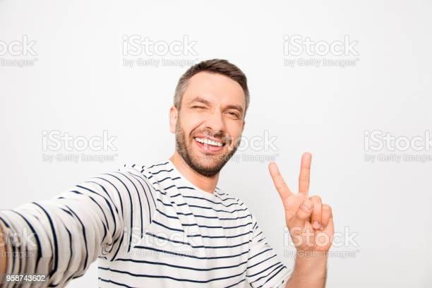 Happy man making selfie and showing two fingers picture id958743602?b=1&k=6&m=958743602&s=612x612&h=f xhfwi5mcccthj3hx wypavv7 odaznw abcjzyog8=