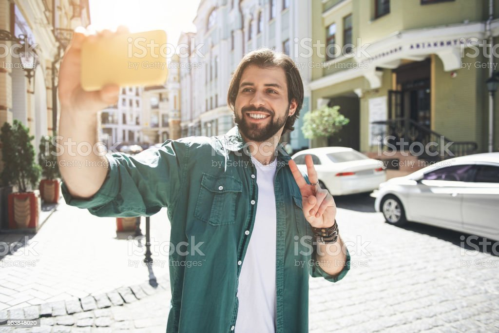 Happy man making selfie in town square - Royalty-free Adult Stock Photo