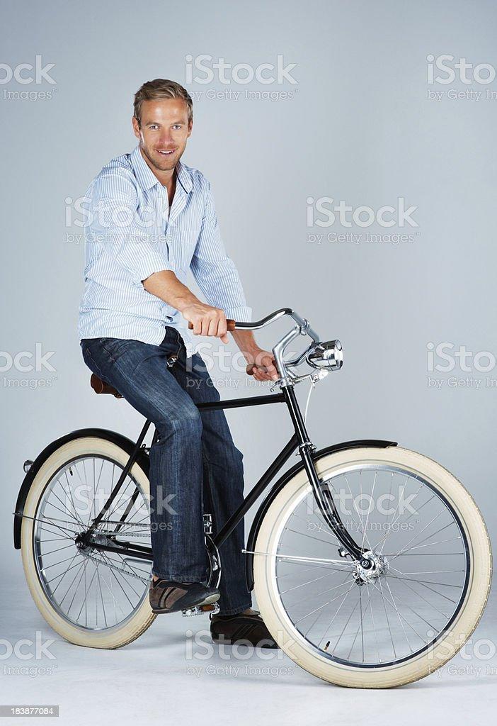 Happy man on retro bike stock photo