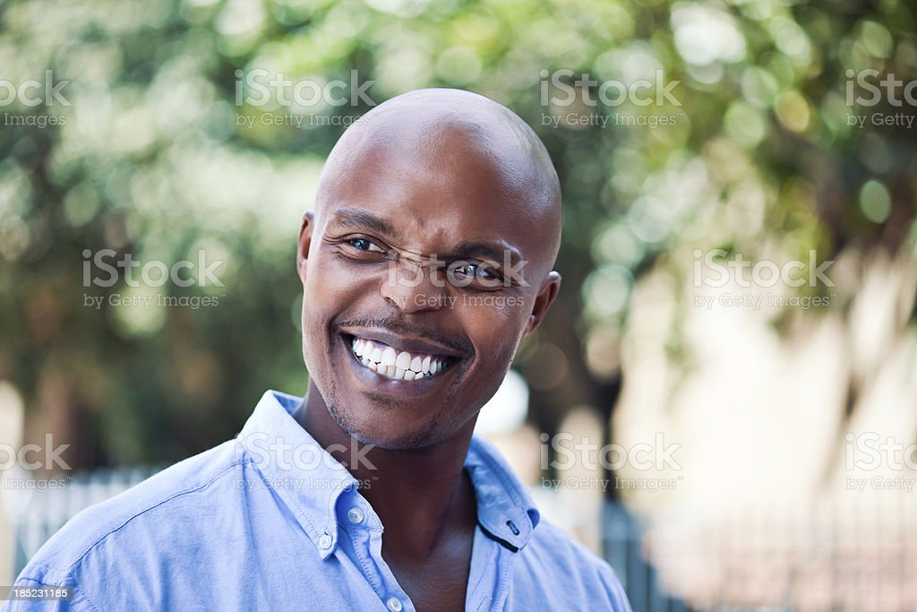 Happy Man, Outdoor Portrait Outdoor Portrait of happy african man. Adult Stock Photo