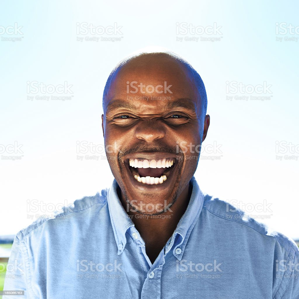 Happy man Happy man laughing at the camera against blue sky. Adult Stock Photo