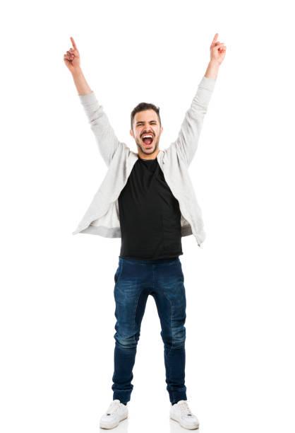 glücklicher mann - arme hoch stock-fotos und bilder
