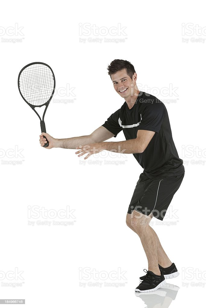 Happy man playing tennis royalty-free stock photo
