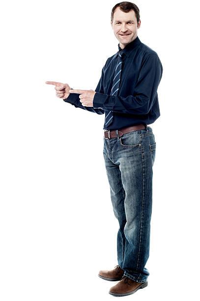Happy man pointing at something stock photo