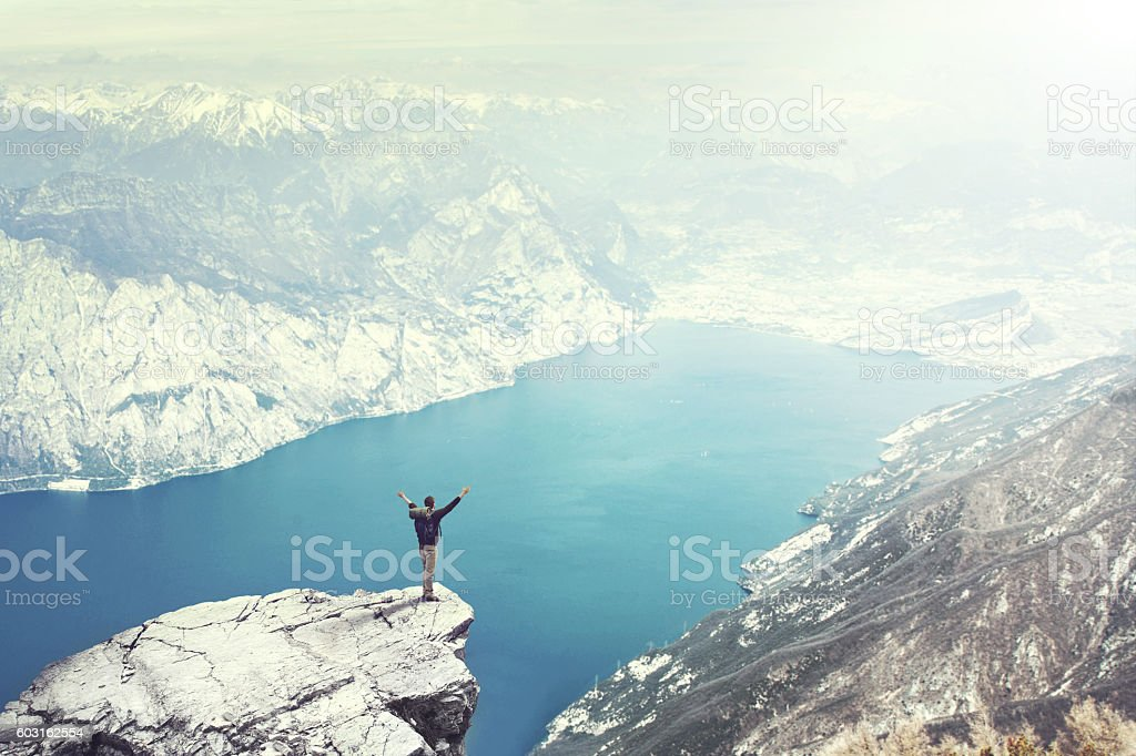 Happy Man reach the top of mountain withstunnig view stock photo