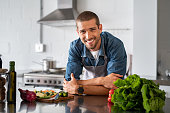 istock Happy man ready to cook in kitchen 1158244991