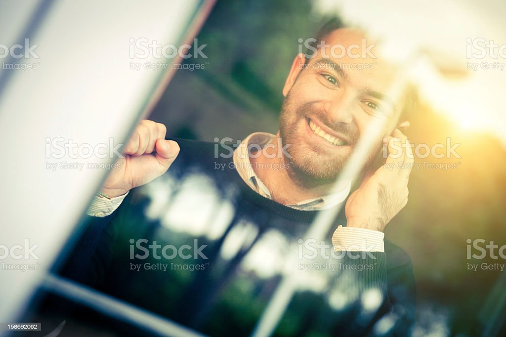Happy man receives a great news on the phone royalty-free stock photo