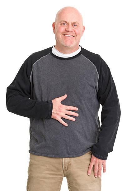 Happy Man Rubs Stomach stock photo
