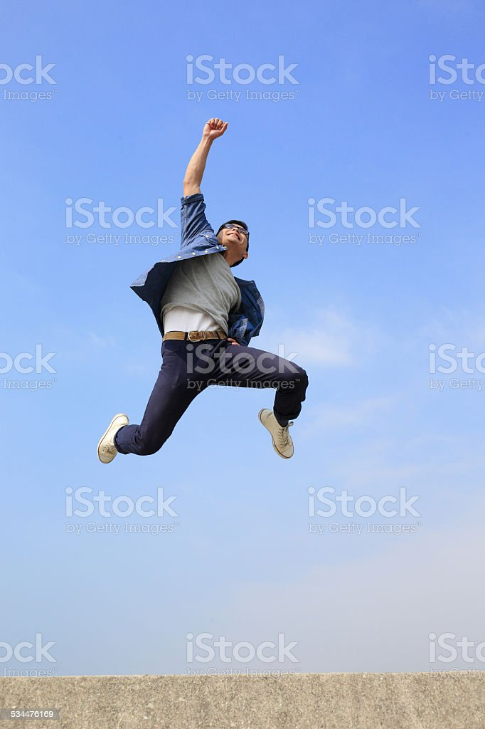 Happy man run and jump stock photo