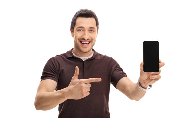Happy man showing a phone and pointing ストックフォト