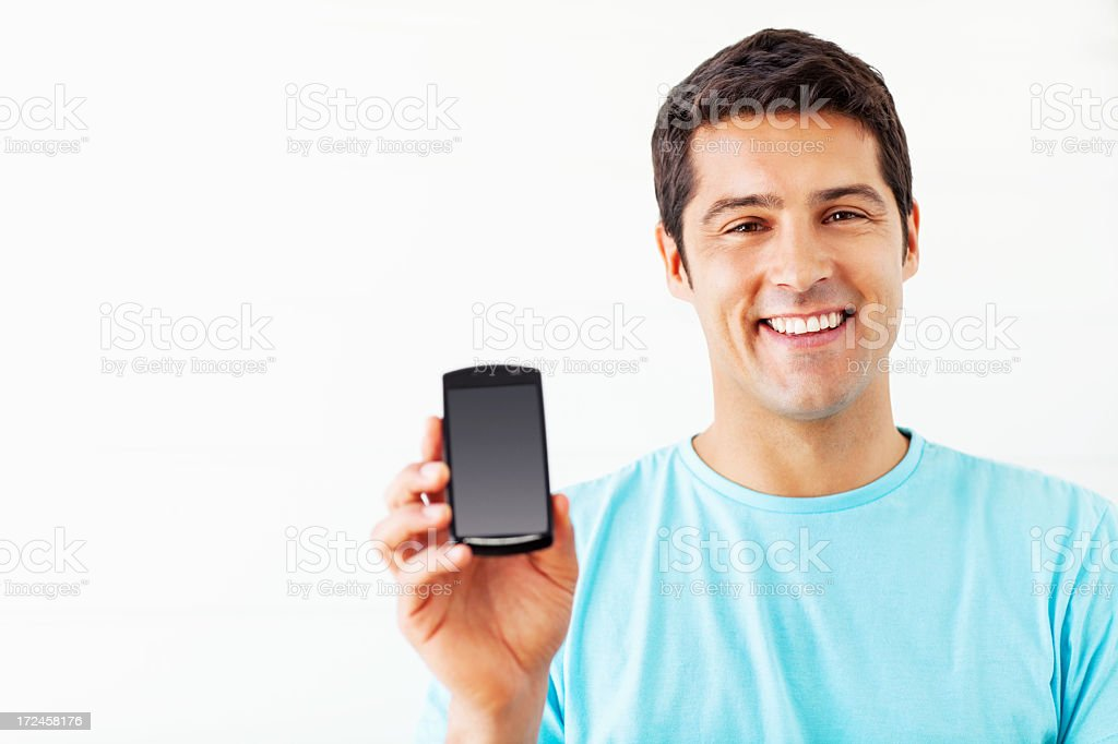 Happy Man Showing Smart Phone royalty-free stock photo