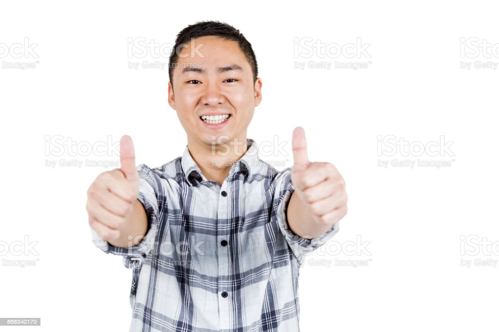 Happy man showing thumps up a stock photo