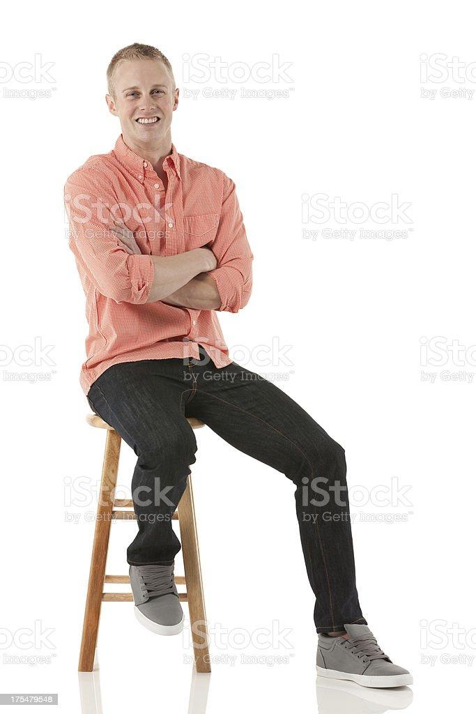 Happy man sitting on a stool royalty-free stock photo