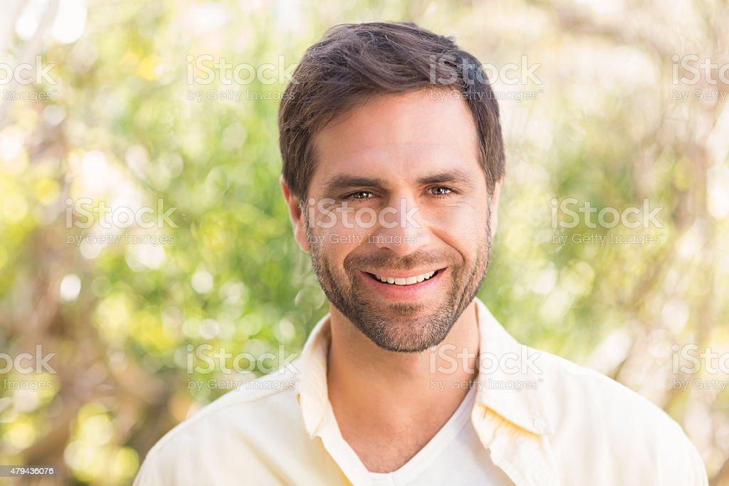 Happy man smiling at camera stock photo