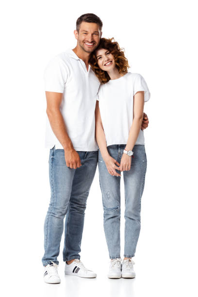 happy man smiling while hugging cheerful woman on white stock photo