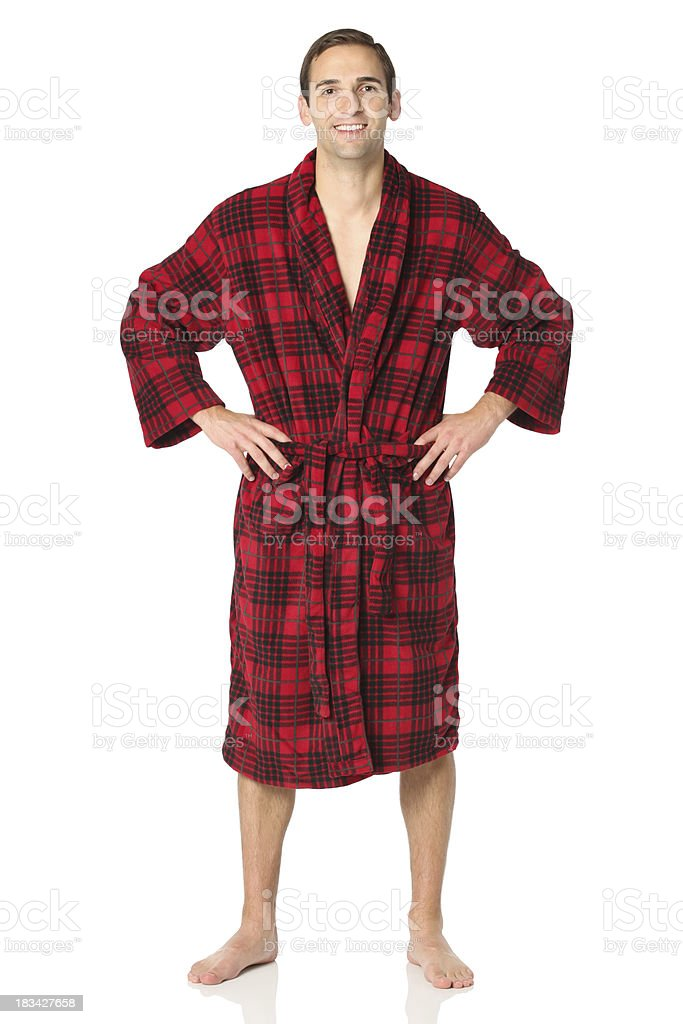 Happy man standing in a bath robe stock photo