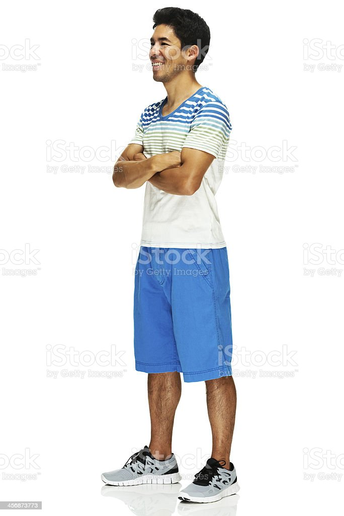 Happy man standing with arms crossed royalty-free stock photo