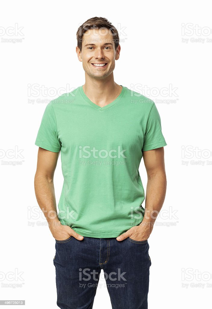 Happy Man Standing With Hands In Pockets stock photo
