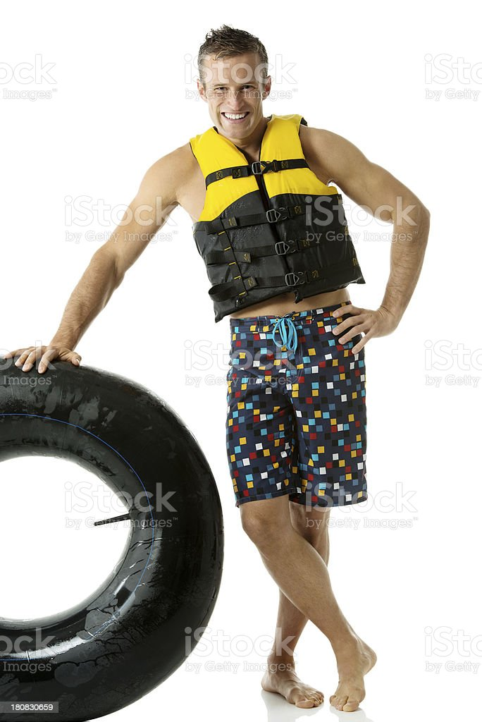 Happy man standing with inner tube royalty-free stock photo