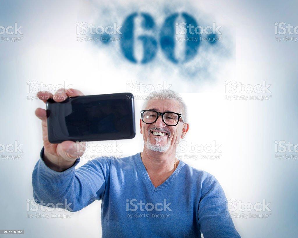 happy man takes a selfie at his sixtieth birthday stock photo