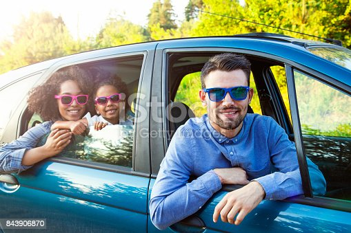 972962180 istock photo Happy Man Taking Family For Road Trip In Car 843906870