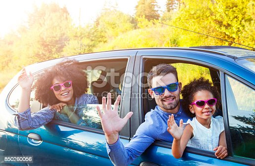 972962180 istock photo Happy Man Taking Family For Road Trip In Car 850260056