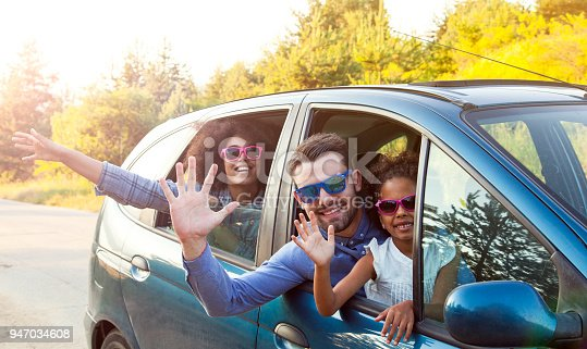 972962180 istock photo Happy Man Taking Family For Road Trip In Car 947034608