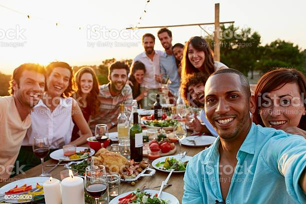 Happy man taking selfie with friends picture id605559093?b=1&k=6&m=605559093&s=612x612&h=8wlndhpt1y m   t7cs4ss0q oa9y0sdkqmdxohup7c=