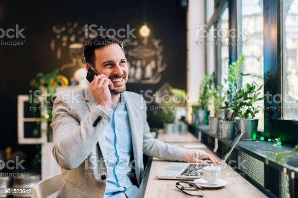 Happy man talking over mobile or smartphone handsome man working in picture id961523642?b=1&k=6&m=961523642&s=612x612&h=wcs qi teb7kxamoay8uiwvhu3pj7fre 8cbtnhv2ls=