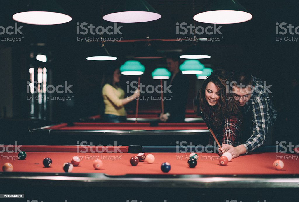 Happy Man Teaching His Girlfriend How To Play Snooker Stock