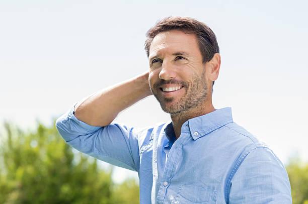 Happy man thinking stock photo