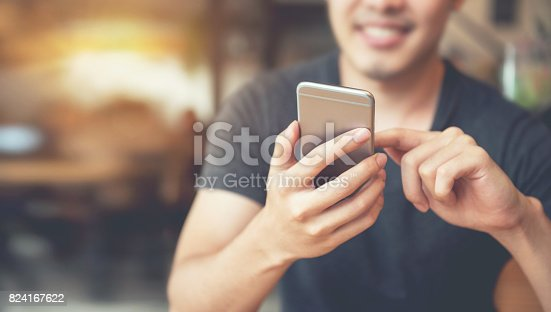 istock Happy man using smartphone and copy space 824167622