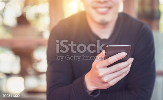 824167622istockphoto Happy man using smartphone and copy space 922311302