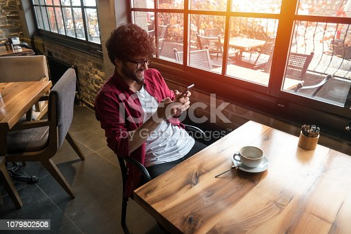 824167622istockphoto Happy man using smartphone 1079802508