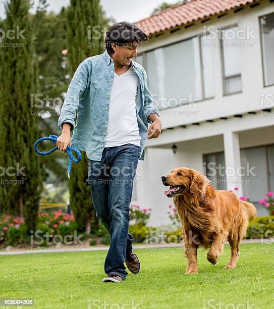 Happy man walking his dog picture id608004308?b=1&k=6&m=608004308&s=612x612&h=wgmmmslrcdvc3ujqpkxwpg2vks5ewt5xhxpnu5viguy=