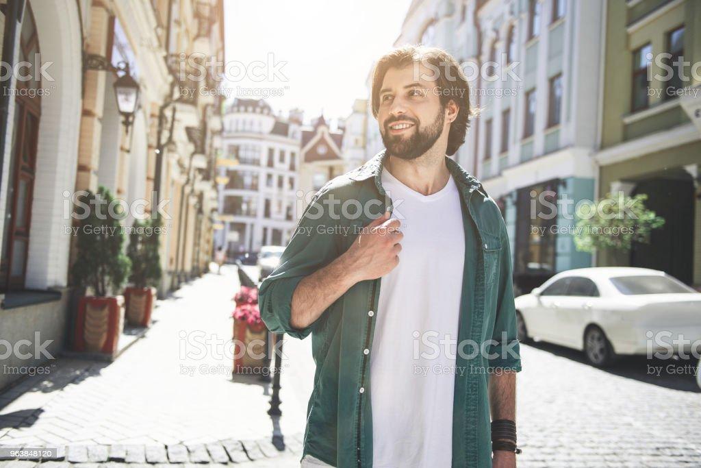 Happy man walking thorough old city block - Royalty-free Adult Stock Photo
